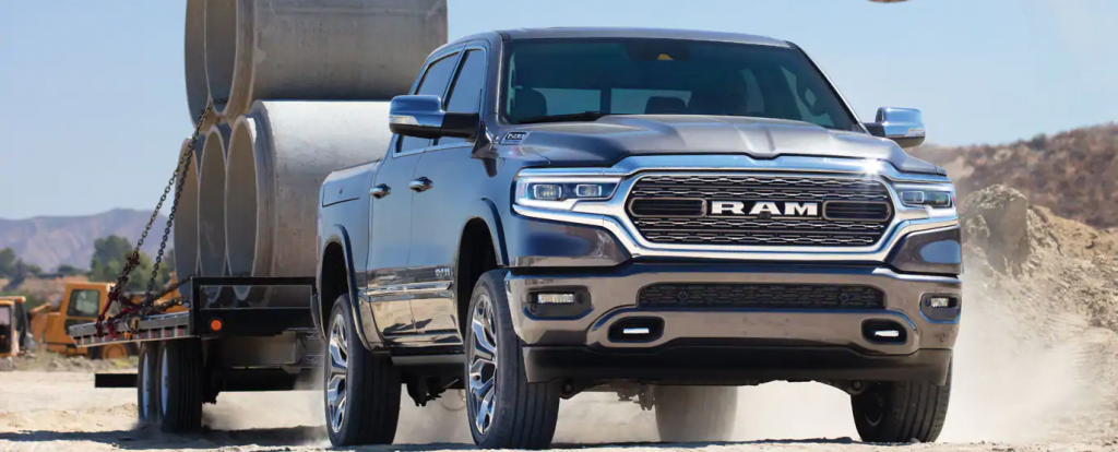 best vehicles for towing a trailer ram 1500 towing a flatbed trailer on a dirt road