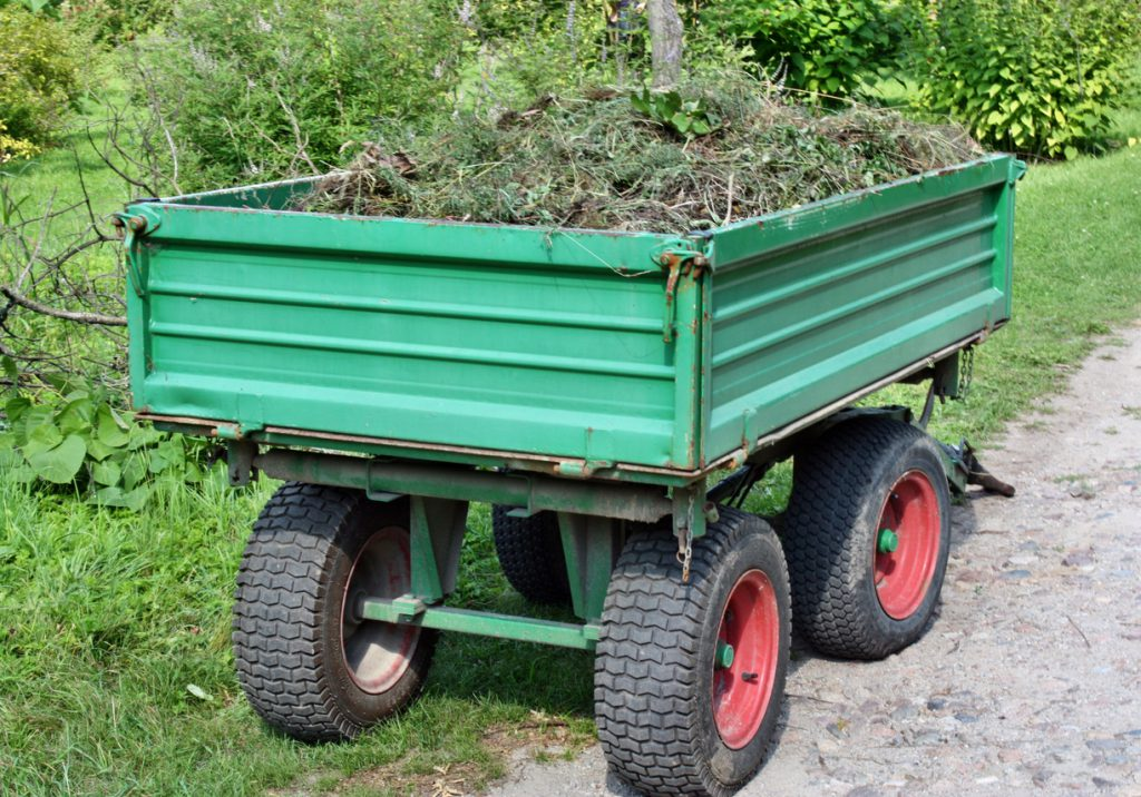 trailer tires - Cleaning trailer with lawn weeds