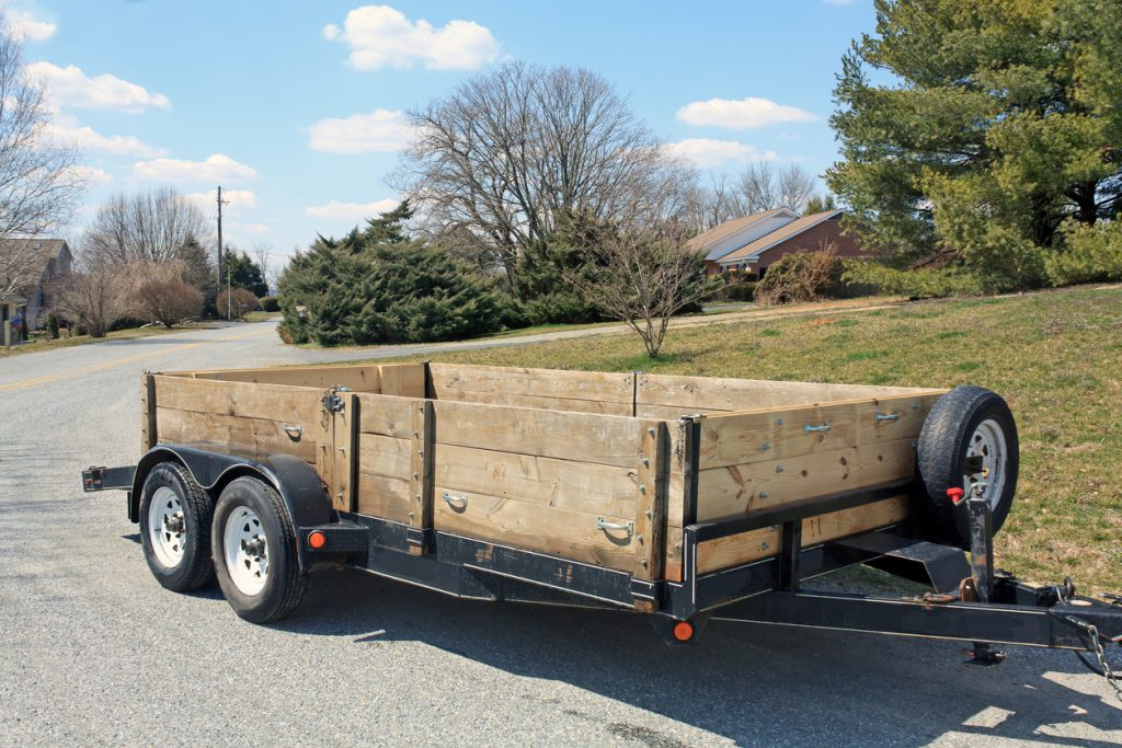 trailer tires - A trailer used to haul construction materials or a car when the sides are down. It was used in an Amish business and pulled by a pick up truck.